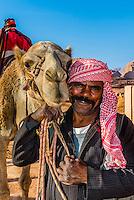 Bedouin man and camel, Arabian Desert, Wadi Rum, Jordan.