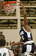 Newburgh Free Academy's Justin Rutty (12) dunks the ball as Cornwall's Brian McNally looks on during a game in Cornwall on Feb. 16, 2007.