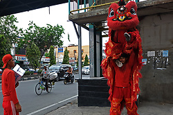 February 6, 2018 - Pekanbaru, Riau, Indonesia - February 6, 2018: The lion dancers in Pekanbaru, Riau Province, Indonesia showcase the lion dance attraction on the streets. This attraction reminds peoples Lunar New Year will soon arrive. (Credit Image: © Dedy Sutisna via ZUMA Wire)