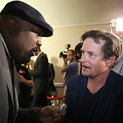 Michael J. Fox gets interviewed by Kendrick from Source Magazine on the red carpet prior to the Mayweather versus Maidana boxing match at the MGM Grand hotel on Saturday, May 3, 2014 in Las Vegas, Nevada.  (AP Photo/Alex Menendez)