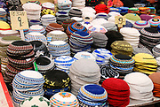 Israel, West Jerusalem Machane Yehuda market A variety of Yarmulkas skullcaps on display