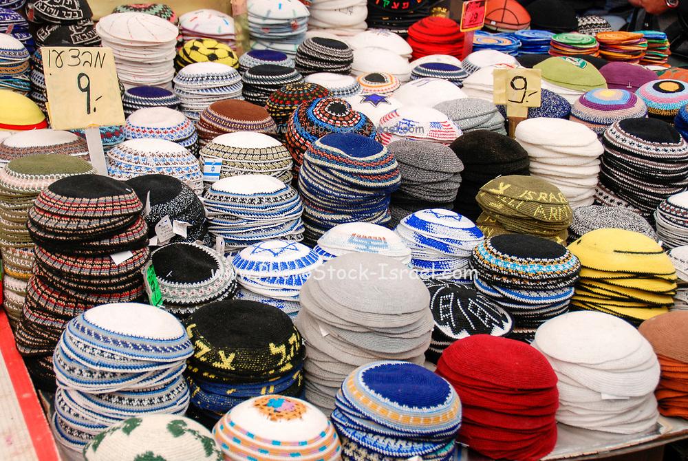 Israel, West Jerusalem Machane Yehuda market A variety of Yarmulkas skullcaps on display
