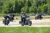Motorcyclists join together to raise money for the Boys and Girls Club of the Lakes Region as they ride around the track at New Hampshire Motor Speedway Saturday, June 15, 2013.    Karen Bobotas/for the Laconia Daily Sun
