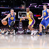 11 April 2014: Golden State Warriors guard Stephen Curry (30) drives past Los Angeles Lakers guard Jodie Meeks (20) during the Golden State Warriors 112-95 victory over the Los Angeles Lakers at the Staples Center, Los Angeles, California, USA.