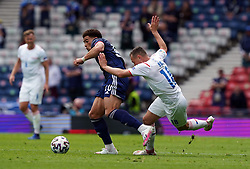 Scotland's Che Adams (left) and Czech Republic's Jan Boril (right) battle for the ball during the UEFA Euro 2020 Group D match at Hampden Park, Glasgow. Picture date: Monday June 14, 2021.