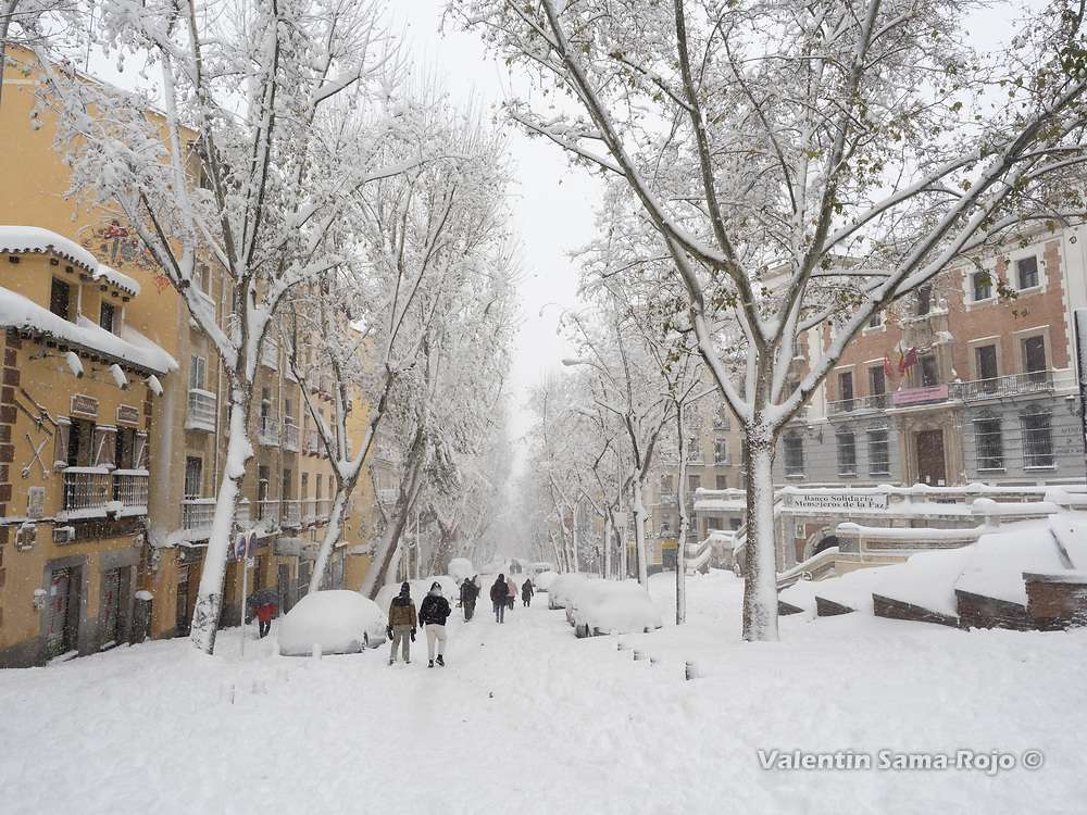 Madrid, Spain. 9 th January, 2021. People walking under a heavy snowfall at Ribera de Curtidores street. Storm Filomena hits Madrid (Spain), a weather alert was issued for cold temperatures and heavy snow storms across Spain; according to the weather agency Aemet is expected to be one of the snowiest days in recent years. © Valentin Sama-Rojo.