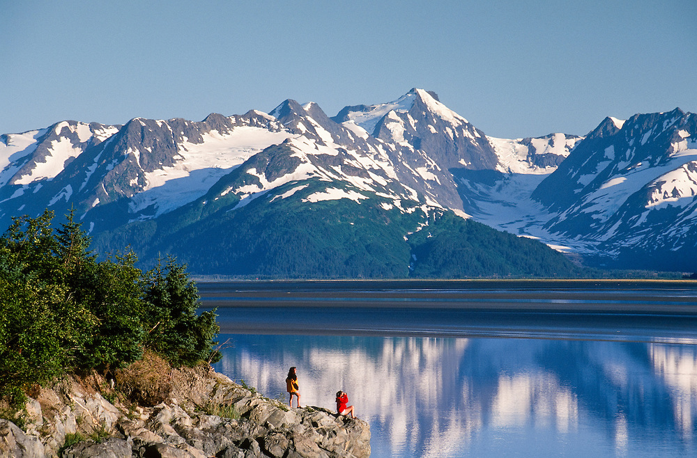 Alaska. Turnagain Arm. Hikers enjoy summer day and view of the Turnagain Arm with Kenai Mountains beyond. MR