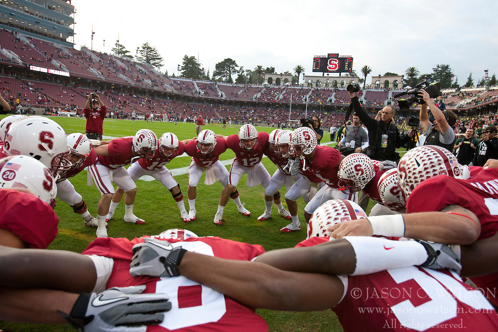 Nov 12, 2011; Stanford CA, USA;  Stanford Cardinal quarterback Andrew Luck (12) leads the offense in a huddle before the game against the Oregon Ducks at Stanford Stadium.  Oregon defeated Stanford 53-30. Mandatory Credit: Jason O. Watson-US PRESSWIRE