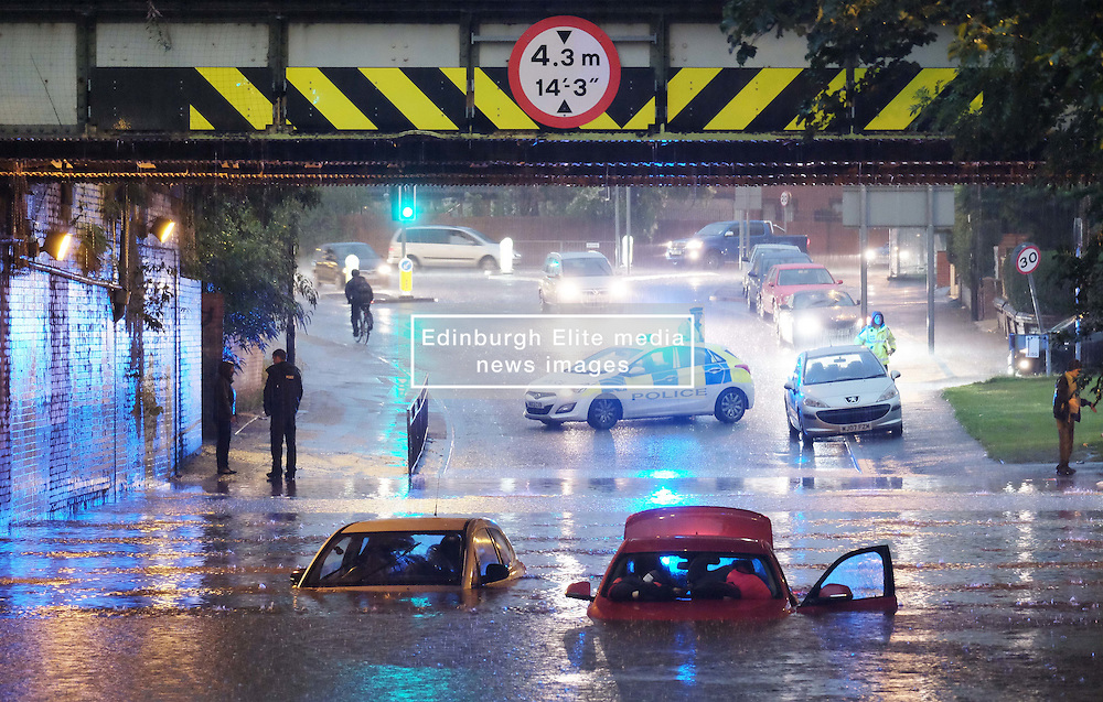 Kirkmanshulme Lane in Manchester was blocked with deep water submerging two cars<br /> <br /> Weather Pictures, Tuesday 13th September 2016<br /> <br /> (c) Alex Todd   Edinburgh Elite media