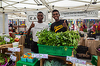 Brooklyn members of Project EATS at their stand on the Rockefeller Center farmers market. Project EATS is a New York City neighborhood-based  urban agriculture project devoted to teaching and helping people in local neighborhoods turn available plots of land into small organic vegetable gardens.  You can read more on their website: http://projecteats.org