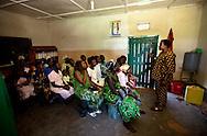 Betty Ajio Buku speaks with mothers at the  Saint Bakhita Health Centre in Yao.