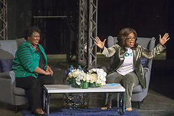 November 1, 2018 - Marietta, Georgia, U.S.- OPRAH WINFREY (right) and Georgia gubernatorial candidate STACEY ABRAMS speak to a crowd gathered for a town hall conversation on Thursday, at the Cobb Civic Center's Jennie T. Anderson Theatre. Winfrey visited Georgia on Thursday to canvass neighborhoods in metro Atlanta and show her support for Abrams. (Credit Image: © Alyssa Pointer/Atlanta Journal-Constitution/TNS via ZUMA Wire)