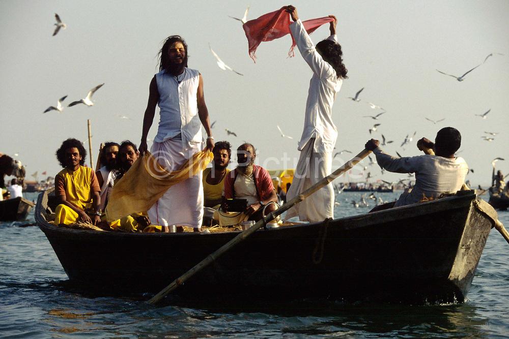 Saddhus in a boat at the Kumbh Mela. Ardh Kumbh Mela 1995, Allahbad, India