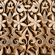A intricate detail design from the Alhambra in Grenada, Spain. The Alhambra is 14th century Islamic palace and fortress built by the Moors for the last Muslim Emirs in Spain.<br />