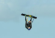 December 31, 2020, Titusville, Florida, USA;  Kiteboarder Carson Lee goes inverted to perform a Stiffy at Parrish Park.