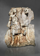 Roman Sebasteion relief sculpture of  an Imperial prince as Diokouros son of zeus, Aphrodisias Museum, Aphrodisias, Turkey.  Against a grey background.<br /> <br /> An imperial youth wearing a military cloak and cuirass of a commander holds the reins of hios horse. This panel is next to a Claudius panel so is probably of Britanicus or Nero the emperors son and intended successor .<br /> <br /> If you prefer to buy from our ALAMY STOCK LIBRARY page at https://www.alamy.com/portfolio/paul-williams-funkystock/greco-roman-sculptures.html . Type -    Aphrodisias     - into LOWER SEARCH WITHIN GALLERY box - Refine search by adding a subject, place, background colour, museum etc.<br /> <br /> Visit our ROMAN WORLD PHOTO COLLECTIONS for more photos to download or buy as wall art prints https://funkystock.photoshelter.com/gallery-collection/The-Romans-Art-Artefacts-Antiquities-Historic-Sites-Pictures-Images/C0000r2uLJJo9_s0