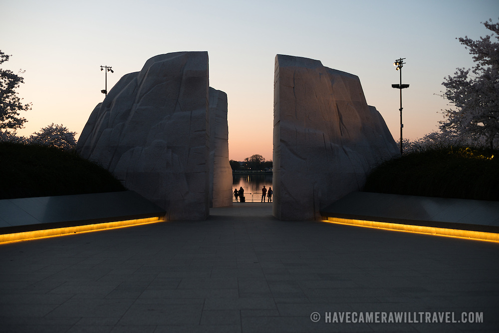 A view of the MLK Memorial before dawn, looking through the Mountain of Hope towards the water of the Tidal Basin in the distance. Opened in 2011, the Martin Luther King Jr Memorial sits on the banks of the Tidal Basin in Washington DC and commemorates the civil rights leader.