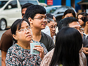 08 NOVEMBER 2015 - YANGON, MYANMAR:  A woman clutches her national ID and voter cards and stands in line to get into her polling place in central Yangon. The citizens of Myanmar went to the polls Sunday to vote in the most democratic elections since 1990. The National League for Democracy, (NLD) the party of Aung San Suu Kyi is widely expected to get the most votes in the election, but it is not certain if they will get enough votes to secure an outright victory. The polls opened at 6AM. In Yangon, some voters started lining up at 4AM and lines were reported to long in many polling stations in Myanmar's largest city.     PHOTO BY JACK KURTZ