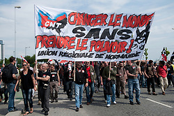 "© licensed to London News Pictures. LE HAVRE, FRANCE. 21/05/11. Members of the CNT anarchist group march through Le Havre, France in protest against the G-8 Summit on 21/05/11. The banner reads ""Change the world without taking power."" Please see special instructions for usage rates. Photo credit should read MICHAEL GRAAE/LNP"