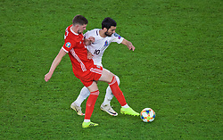 CARDIFF, WALES - Friday, September 6, 2019: Wales' Chris Mepham (L) and Azerbaijan's Mahir Emreli during the UEFA Euro 2020 Qualifying Group E match between Wales and Azerbaijan at the Cardiff City Stadium. (Pic by Paul Greenwood/Propaganda)