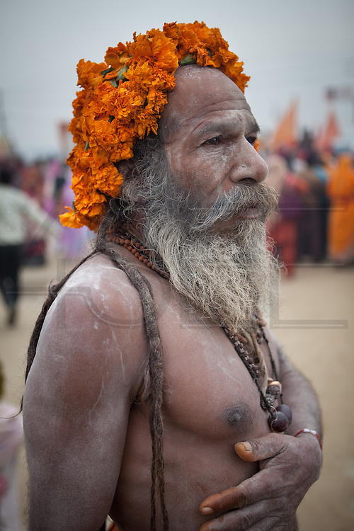 The Naga Sadhus are considered the most primitive state in the spiritual cicle of the Sadhus. They cover their body with ash. February 2013, Allahabad //The Maha Kumbh Mela is believed to be the single largest religious gathering in the world. It's a sacred pilgrimage celebrated every twelve years. In 2013 it has taken place in Allahabad, in the confluence of the rivers Ganga, Yamuna and Saraswati. Millions of hindu people gather on a single day for a ritual bath in the sacred waters of Ganga. The event congregate millions of devotees, sadhus and sadhvis of all the akharas coming from all over India.