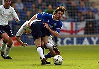 Photograph: Scott Heavey.<br />Leicester City v Tottenham Hotspur. 19/10/2003. FA Barclaycard Premiership.<br />Mussie Izzet goes through Robbie Keane in a strong challenge