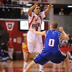 Jan 31, 2009; Piscataway, NJ, USA; Rutgers guard Mike Rosario (3) passes over DePaul guard Michael Bizoukas (0) during the first half of Rutgers game against DePaul in NCAA college basketball at the Louis Brown Athletic Center