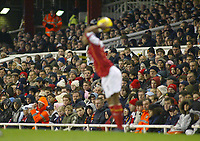 20/11/2004 - FA Barclays Premiership - Arsenal v  - West Bromich Albion - HIghbury Stadium, London<br />As Arsenal's Ashley Cole takes a throw in, there appears to be no repeat of the racist chanting or remarks he received during the week from the Spanish fans during the Spain v England match, from either the Arsenal home fans, or the West Bromich Albion fans in the distance<br />Photo:Jed Leicester/Back Page Images
