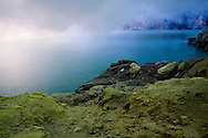 Fumes rise out of the crater lake at the Kawah Ijen Sulphur Mines in East Java, Indonesia, Southeast Asia