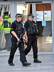 Licensed to London News Pictures 05/09/2012 Manchester, UK. Armed police block roads around Manchester Magistrates Court amidst tight security as Anthony Wilkinson faces a first court appearance charged with murder, attempted murder and possession of a firearm with intent to endanger life. Credit: Julian Brown/LNP