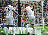Football - 2018 / 2019 Emirates FA Cup - Semi-Final: Wolverhampton Wanderers vs. Watford<br /> <br /> Raul of Wolves goes behind the goal to find his mask under a towel after scoring goal no 2, at Wembley Stadium.<br /> Willy Boly (left)<br /> <br /> COLORSPORT/ANDREW COWIE