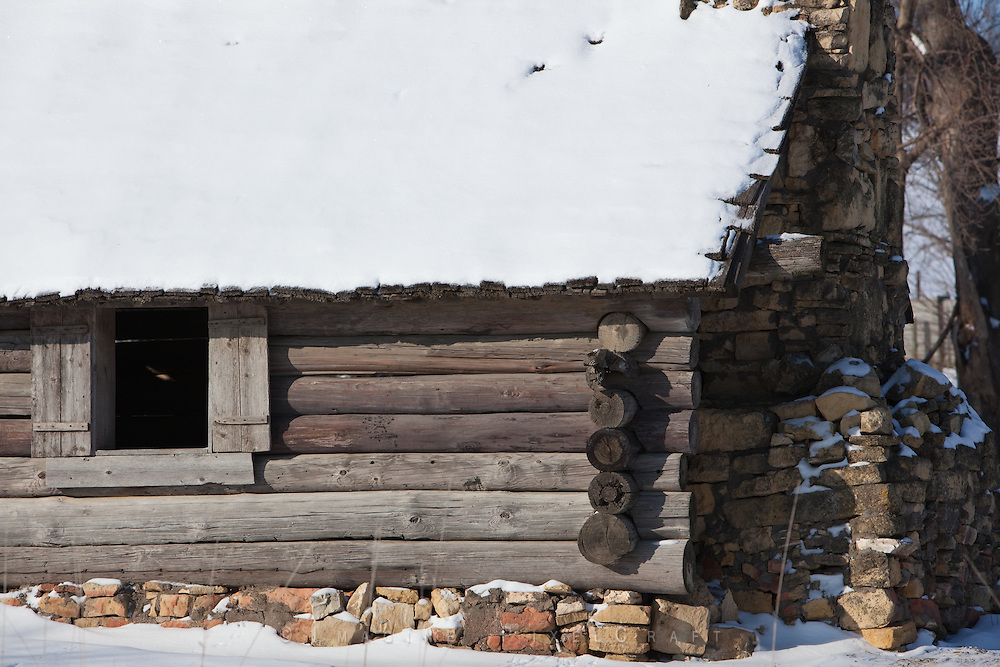 Log Cbin in the snow, no longer used but respected.