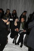 Jasmine Guinness and Gawaine Rainey, DENIS SIMACHEV SHOWCASES AUTUMN/WINTER 06 MENSWEAR & WOMENSWEAR COLLECTIONS<br />AT CHELSEA FOOTBALL CLUB. Supported by Vogue Russia<br />11 April 2006. ONE TIME USE ONLY - DO NOT ARCHIVE  © Copyright Photograph by Dafydd Jones 66 Stockwell Park Rd. London SW9 0DA Tel 020 7733 0108 www.dafjones.com