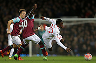 Michail Antonio of West Ham United challenges Divock Origi of Liverpool. The Emirates FA cup, 4th round replay match, West Ham Utd v Liverpool at the Boleyn Ground, Upton Park  in London on Tuesday 9th February 2016.<br /> pic by John Patrick Fletcher, Andrew Orchard sports photography.