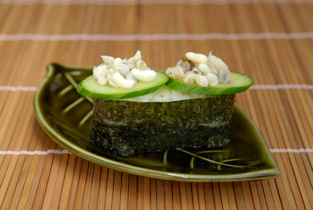 """Green tree ant larvae sushi. Tokyo resident Shoichi Uchiyama is the author of """"Fun Insect Cooking"""". His blog on the topic gets 400 hits a day. He believes insects could one day be the solution to food shortages, and that rearing bugs at home could dispel food safety worries."""
