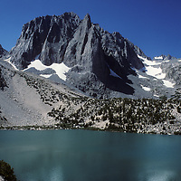 Temple Crag towers above Second Lake in Big Pine Canyon of California's Sierra Nevada. Behind on the right are North Palisade and other peaks above the Palisade Glacier, which is just out of view.