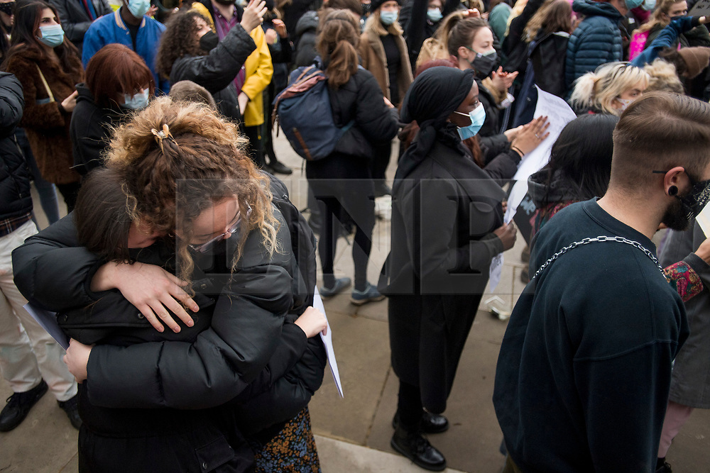 © Licensed to London News Pictures. 14/03/2021. London, UK. Two emotional protestors embrace outside Parliament in London for a demonstration, organised by Sisters Uncut, against the actions of the police force at a vigil for murdered Sarah Everard yesterday evening. There have been calls for Met Chief Cressida Dick to resign following yesterday's scenes, when police dragged women away from a bandstand as thousands gathered in Clapham, South London. Photo credit: Ben Cawthra/LNP