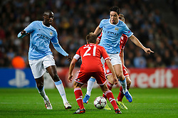 Man City Midfielder Samir Nasri (FRA) is challenged by Bayern Defender Philipp Lahm (GER) during the first half of the match - Photo mandatory by-line: Rogan Thomson/JMP - Tel: Mobile: 07966 386802 - 02/10/2013 - SPORT - FOOTBALL - Etihad Stadium, Manchester - Manchester City v Bayern Munich - UEFA Champions League Group D.