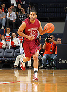 Nov 6, 2010; Charlottesville, VA, USA; Roanoke College g Melvin Felix (12) dribbles the ball Saturday afternoon in exhibition action at John Paul Jones Arena. The Virginia men's basketball team recorded an 82-50 victory over Roanoke College.