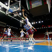 Anadolu Efes's Dogus Balbay (R) during their Turkish Basketball League match Anadolu Efes between Trabzonspor at Abdi Ipekci Arena in Istanbul Turkey on Sunday 19 October 2014. Photo by Aykut AKICI/TURKPIX