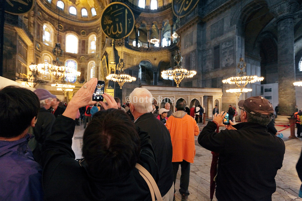 tourists photographing inside the Hagia Sophia Museum Istanbul Turkey