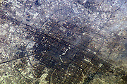 2005 The large city Beijing (Peking), China is featured in this image photographed by Expedition 10 Commander Leroy Chiao on the International Space Station.