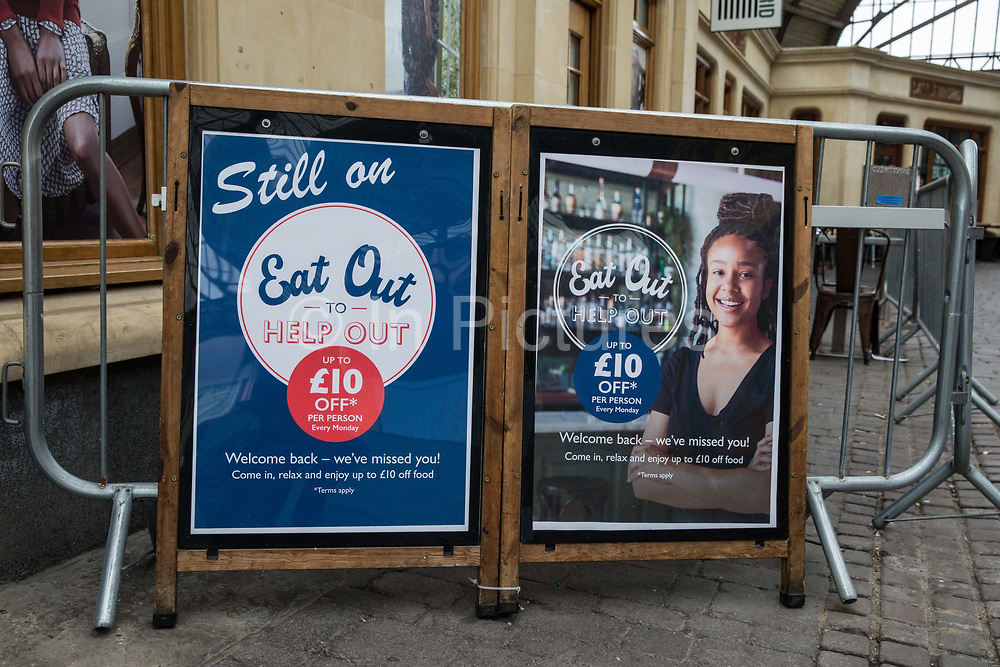 """Eat Out To Help Out notices are pictured on the second day of England's second coronavirus lockdown on 6 November 2020 in Windsor, United Kingdom. Only retailers selling """"essential"""" goods and services are permitted to open to the public during the second lockdown and cafes, restaurants and pubs must remain closed unless they are providing food and drink for takeaway before 10pm, click-and-collect, drive-through or delivery."""