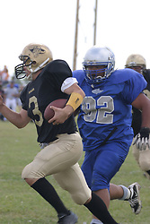 14 August 2004  Storms Christian Bailey closes in as Outlaws QB Dan Eck rolls out looking for a receiver.   Twin City Storm V Capitol City Outlaws, Midwest Football League, Interstate Center, Bloomington-Normal IL