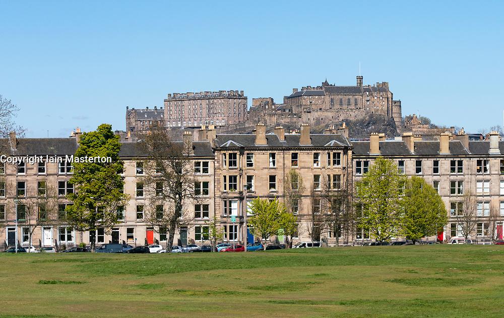 View of tenement apartment buildings overlooking  Bruntsfield Links in Edinburgh with Edinburgh Castle to rear, Scotland, UK