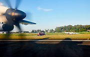 Laos. Landing at Vientiane airport aboard a Lao Airlines ATR 72 past a wrecked Lao Skyway MA-60 airplane.