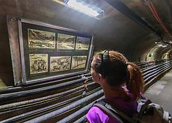 THEMENBILD - eine Frau blickt auf alte Fotos vom Bau der Hochgebirgsstausseen Mooserboden im Inneren der Staumauer aufgenommen am 15. Juni 2017, Kaprun, Österreich // A woman looks at old photos of the construction of the Mooserboden high mountain reservoirs inside the Staumauer on 2017/06/15, Kaprun, Austria. EXPA Pictures © 2017, PhotoCredit: EXPA/ JFK