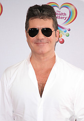 © Licensed to London News Pictures. 02/06/2014, UK. Jim Simon Cowell, Health Lottery Tea Party, The Savoy Hotel, London UK, 02 June 2014. Photo credit : Brett D. Cove/Piqtured/LNP
