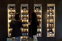 In a neighborhood otherwise given to art and antique galleries, Pierre Marcolini?s store, with its lean furnishings and black glass topped cabinets resembles more a Tiffany jewelry store than a chocolate shop. His chocolates, with their tiny gold lettering or gold filament decorations, evoke more microchips than Mars bars.