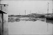 "ackroyd_20334-R1-5A.  ""Liquid Air. flood damage. December 13, 1977"" (3200 NW Yeon. 35mm. Industrial Air Products Inc., Liquid Air Inc., Schnitzer Steel Industries, )"